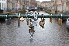 Bicycle locks hanging on the bridge Royalty Free Stock Photography