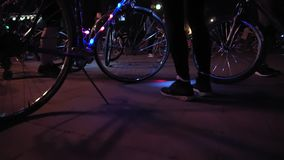 Bicycle with luminous garland. On a parade of cyclists at night in the city stock video