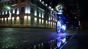 Bicycle in a luminous suit, on a luminous bike drove past the camera. Costume for Halloween. stock video footage