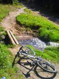 Bicycle lying on mountain path Stock Photo