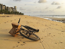 Bicycle lying on the sand of a beach in Brazil Stock Photo