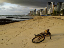 Bicycle lying on the sand of a beach in Brazil Stock Photography