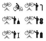 Bicycle man and stand holder service repair icon set Royalty Free Stock Photos