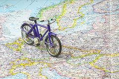 Bicycle on map of Europe. Bicycle on map exploring the continents saving gas Stock Photography