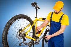 Bicycle mechanic adjusting front derailleur Stock Images