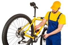 Bicycle mechanic adjusting front derailleur Stock Image