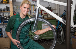 Bicycle mechanic repairing wheel on bike in a workshop Royalty Free Stock Photos
