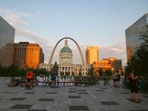 Bicycle Meet Up in St. Louis. ST. LOUIS, MO - JULY 9, 2018: A group male and female bicycle enthusiasts gather near the fountain in Kiener Plaza Park, with Old Stock Images