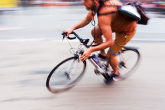 Bicycle messenger in motion blur Stock Photos