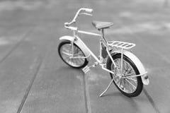 Bicycle model on wood floor Stock Photo