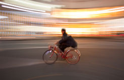Bicycle in motion blur. A person on a bicycle during a motion blur Royalty Free Stock Images