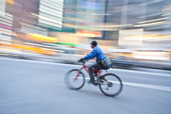 Bicycle in motion blur. A bicycle in motion blur while moving at a fast speed down the street Stock Images