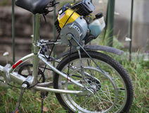 Bicycle with a motor of the lawnmower Stock Photo