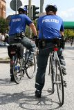 Bicycle-mounted police officers Stock Photo