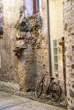 Bicycle on narrow street Stock Images