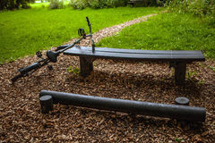 Bicycle near bench in park Stock Photos