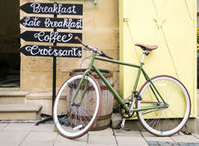 A bicycle near cafe sign Royalty Free Stock Photography