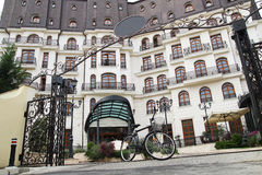 Bicycle near hotel. Bicycle near the hotel entrance, gate Stock Photos