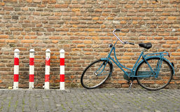 Bicycle near lay columns. In Holland Stock Photography