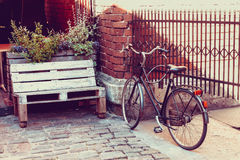 Bicycle near outdoors cafe on old street. Royalty Free Stock Photography