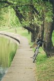 Bicycle near a reservoir in park/bicycle in park near a reservoir royalty free stock photo