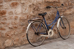 Bicycle near stone wall. Stock Images