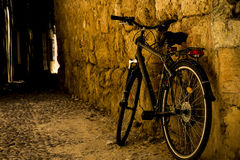 Bicycle near the wall in the yard. Bike in the yard near the wall royalty free stock images