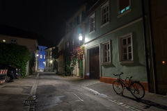 Bicycle on the night european city street Stock Photos