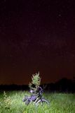 Bicycle in a night steppe. Under a starry sky stock photos