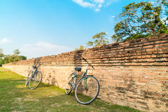 Bicycle with old brick wall in the temple Royalty Free Stock Images