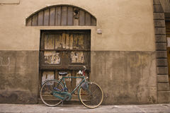 Bicycle and old building Stock Images