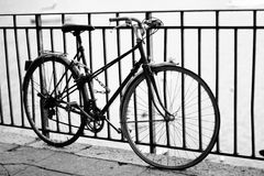 Bicycle. Old bicycle near fence with nobody Stock Photos