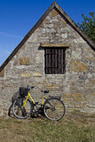Bicycle with old stone house Stock Images