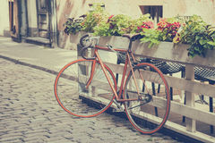 Bicycle on old street. Vintage styled. Stock Photos