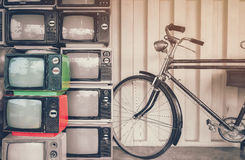 Bicycle and old TV on the retro yellow background. To illustrate Royalty Free Stock Photos