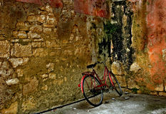 Bicycle and an old wall Stock Photos