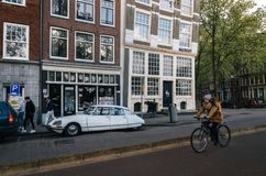 Bicycle and oldtimer in Amsterdam royalty free stock photos