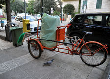 Bicycle operator ecological. Old tricycle used for the cleaning of the streets in the city Royalty Free Stock Photo