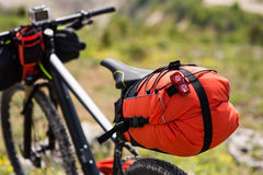 Bicycle with orange bags for travel Stock Photography