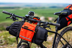 Bicycle with orange bags for travel Royalty Free Stock Photos