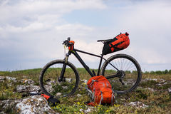 Bicycle with orange bags for travel Royalty Free Stock Photography