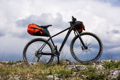 Bicycle with orange bags for travel Stock Photo