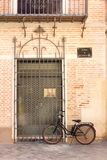Bicycle outside door in Malaga Stock Photos
