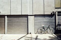 Bicycle outside garage Royalty Free Stock Image
