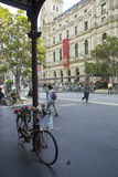 Bicycle outside GPO. Melbourne, Australia-March 20th 2013: Bicycle and people walking past the GPO. The Victorian former General Post Office building was adapted Royalty Free Stock Photo