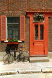 Bicycle outside house. A bicycle parked outside a house, next to the door Stock Images