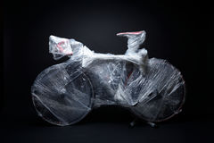 The bicycle is packed by bubble warp for transportation Royalty Free Stock Photos