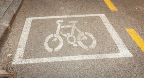 Bicycle painted white on the road to indicate a bicycle pisa Royalty Free Stock Photos