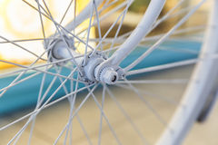 Bicycle painted white standing on the street Royalty Free Stock Image