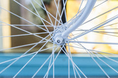 Bicycle painted white standing on the street Royalty Free Stock Images